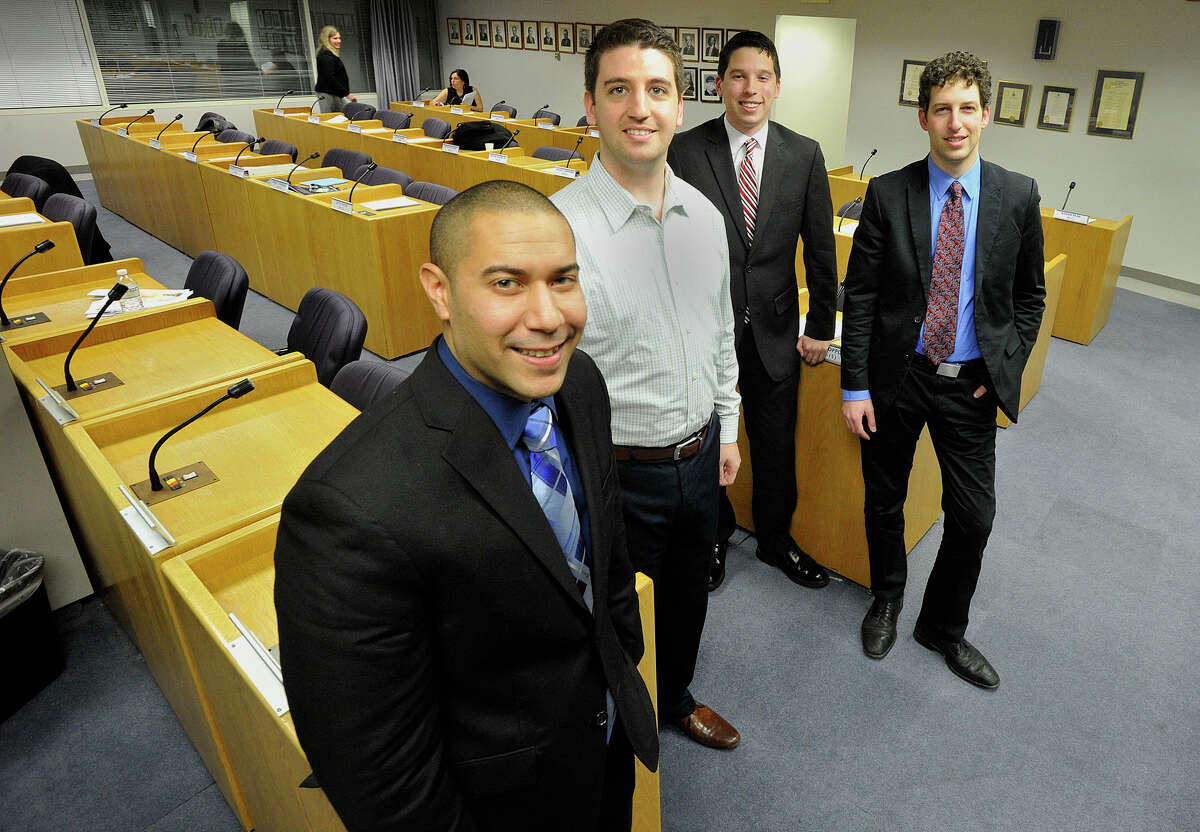 Newly elected members of the Stamford Board of Representatives that are under the age of 35 are, from left, Matthew Quinones (D-16), Brien Buckman (D-12), Steven Kolenberg (R-16) and David Kooris (D-6). Photographed in the legislative chamber at the Stamford Government Center on Monday, Dec. 9, 2013.