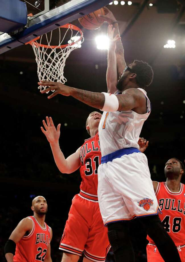 New York Knicks forward Amare Stoudemire (1) dunks over Chicago Bulls forward Erik Murphy (31) in the first half of their NBA basketball game at Madison Square Garden in New York, Wednesday, Dec. 11, 2013.  (AP Photo/Kathy Willens) ORG XMIT: MSG105 Photo: Kathy Willens / AP
