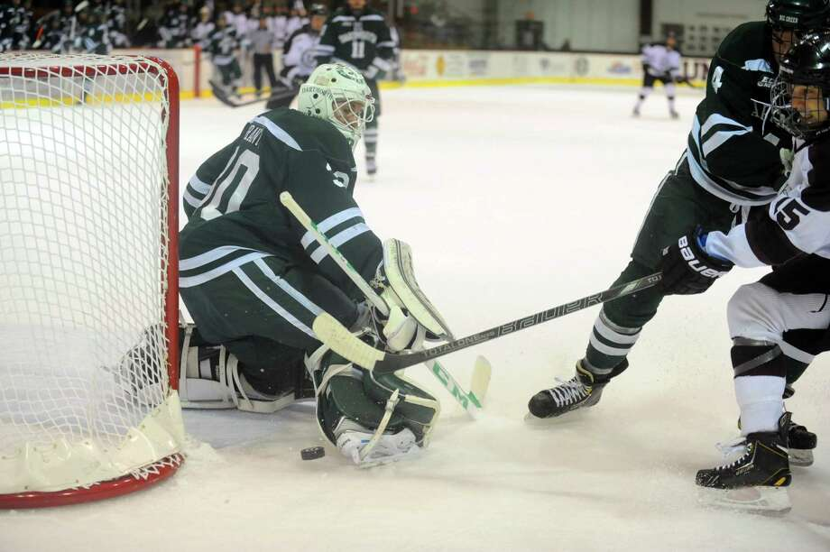 Union's Matt Hatch, right, just misses a goal against Dartmouth goalie Charles Grant during their men's hockey game on Wednesday Dec. 11, 2013 in Schenectady, N.Y.  (Michael P. Farrell/Times Union) Photo: Michael P. Farrell / 00024976A