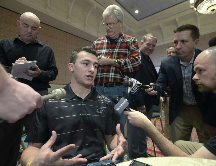 Texas A&M quarterback Johnny Manziel addresses media about his decision-making process regarding the NFL and other topics prior to tonight's College Football Awards show Wednesday in Lake Buena Vista, Fla. Photo: Phelan M. Ebenhack / Associated Press / FR121174 AP