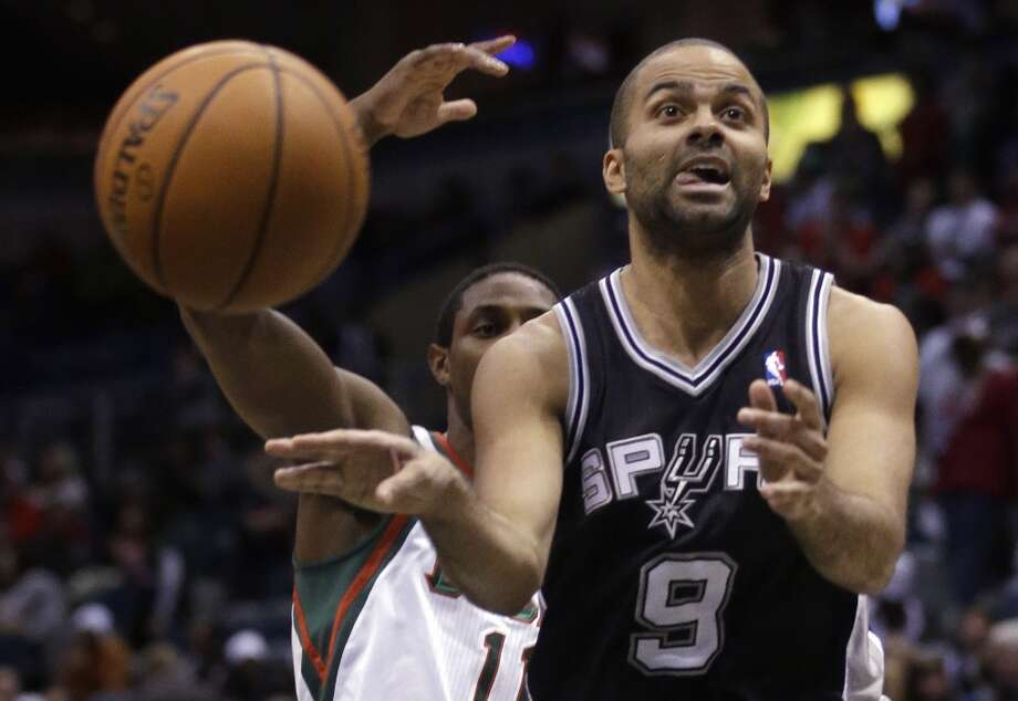 San Antonio Spurs' Tony Parker(9) passes the ball in front of Milwaukee Bucks' Brandon Knight during the second half of an NBA basketball game Wednesday, Dec. 11, 2013, in Milwaukee. (AP Photo/Morry Gash) Photo: Associated Press
