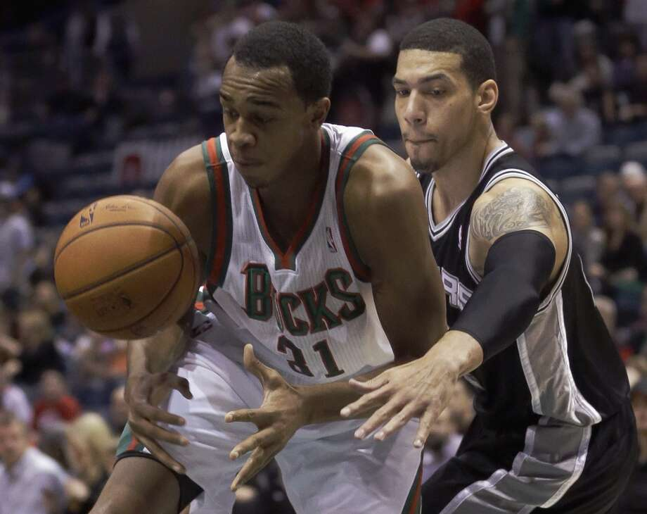 Milwaukee Bucks' John Henson(31) and San Antonio Spurs' Danny Green go after a loose ball during the first half of an NBA basketball game Wednesday, Dec. 11, 2013, in Milwaukee. (AP Photo/Morry Gash) Photo: Associated Press