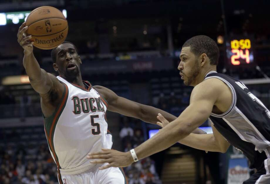 Milwaukee Bucks' Ekpe Udoh goes after a ball in front of San Antonio Spurs' Jeff Ayres during the first half of an NBA basketball game Wednesday, Dec. 11, 2013, in Milwaukee. (AP Photo/Morry Gash) Photo: Associated Press