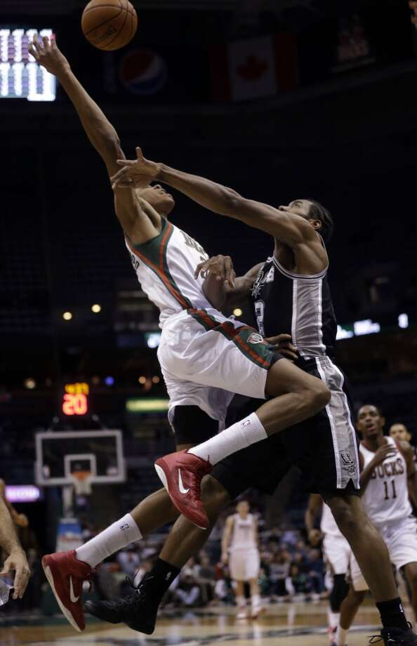 Milwaukee Bucks' Giannis Antetokounmpo, left,  is fouled by San Antonio Spurs' Kawhi Leonard as he shoots during the first half of an NBA basketball game Wednesday, Dec. 11, 2013, in Milwaukee. (AP Photo/Morry Gash) Photo: Associated Press