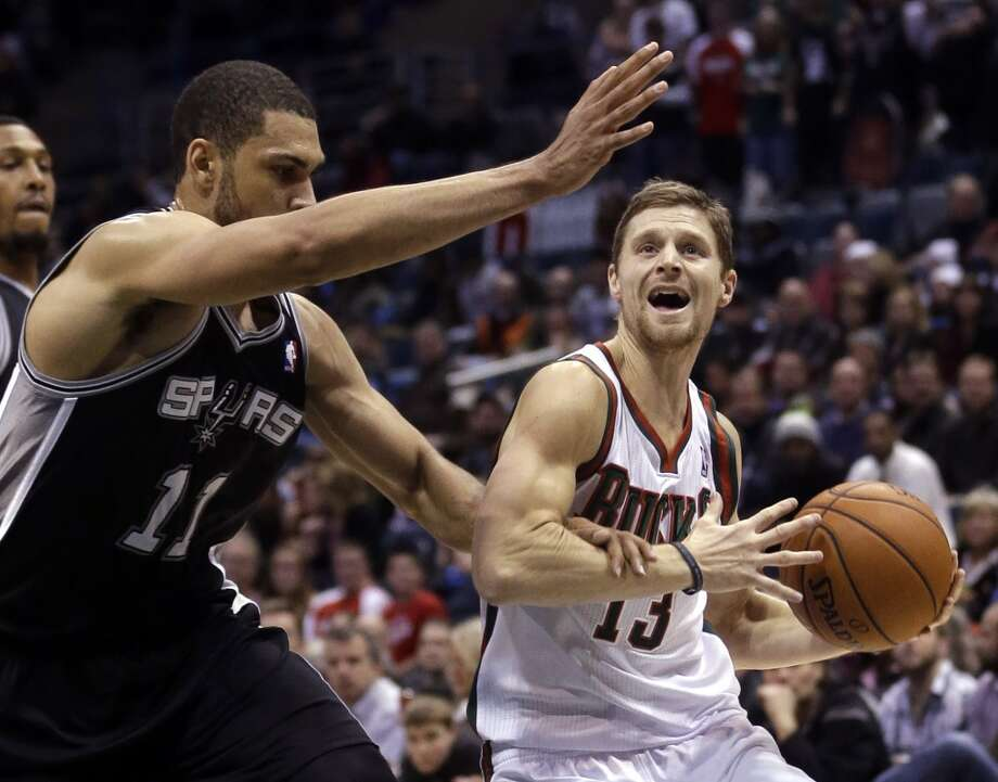 Milwaukee Bucks' Luke Ridnour(13) is fouled by San Antonio Spurs' Jeff Ayres(11) as he drives during the first half of an NBA basketball game Wednesday, Dec. 11, 2013, in Milwaukee. (AP Photo/Morry Gash) Photo: Associated Press