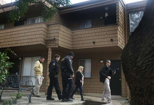 Law enforcement officers including some from Alamo Heights Police Department, leave the Treehouse Apartments after inspecting the apartment, above right, of Robert Cameron Redus, a UIW student from Baytown, TX who was shot to death by UIW campus police officer Chris Carter.   Friday, Dec. 6, 2013. Photo: BOB OWEN, San Antonio Express-News