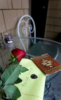 A note for the Redus family with a charm and a rose was placed outside the apartment of Robert Cameron Redus, a UIW student from Baytown, TX, who was shot to death by UIW campus police officer Chris Carter.   Friday, Dec. 6, 2013. Photo: San Antonio Express-News