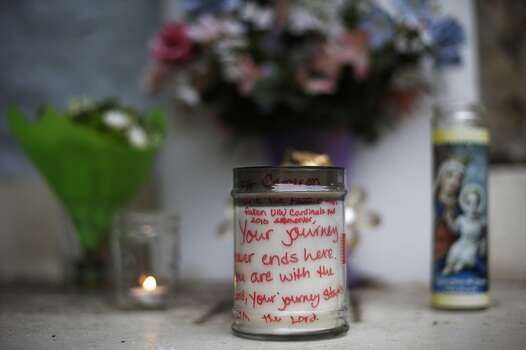 A note written on a candle is left with a memorial on the University of the Incarnate Word campus for senior Robert Cameron Redus, Wednesday, Dec. 11, 2013, in San Antonio. Redus, 23, was shot and killed by a campus police officer on Friday. (AP Photo/Eric Gay) Photo: Associated Press