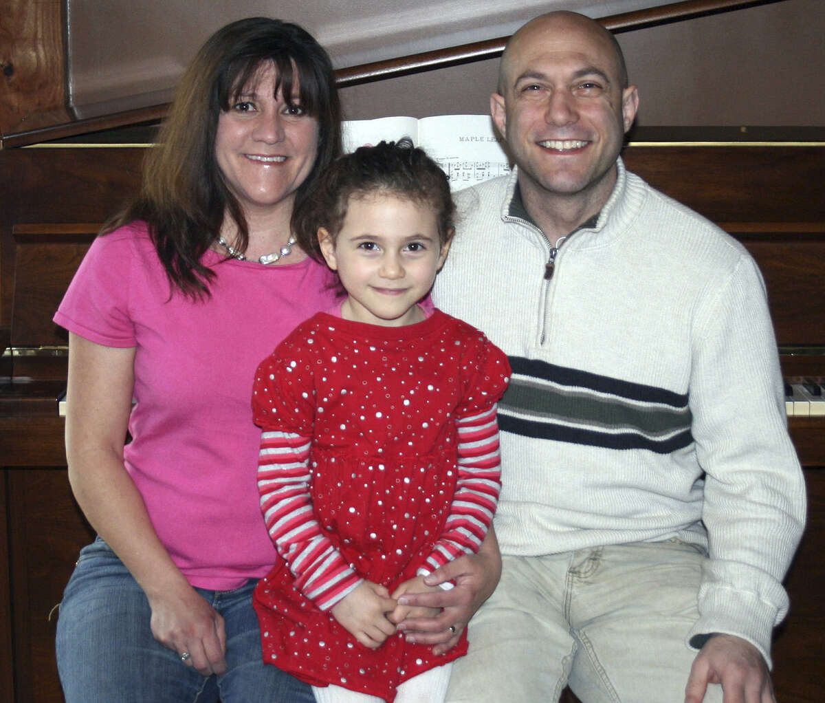 Avielle Richman, shown with parents Jennifer Hensel and Jeremy Richman, was among the students killed at Sandy Hook. A service for the victims was held on Capitol Hill.