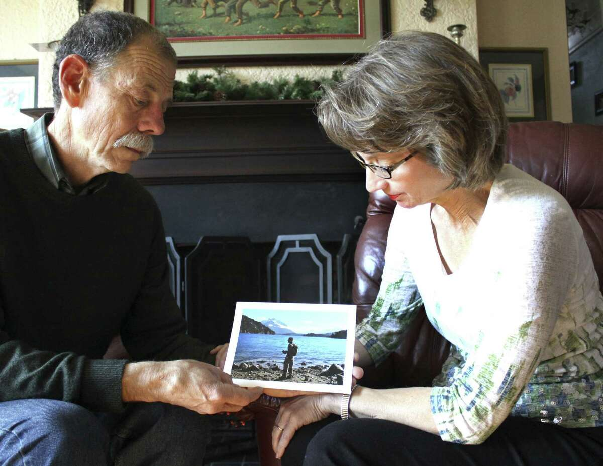 Mickey and Valerie Redus look at a photograph of their son Robert Cameron Redus at their home in Baytown. The UIW student's brother Everett took the photo in Bariloche, Argentina.