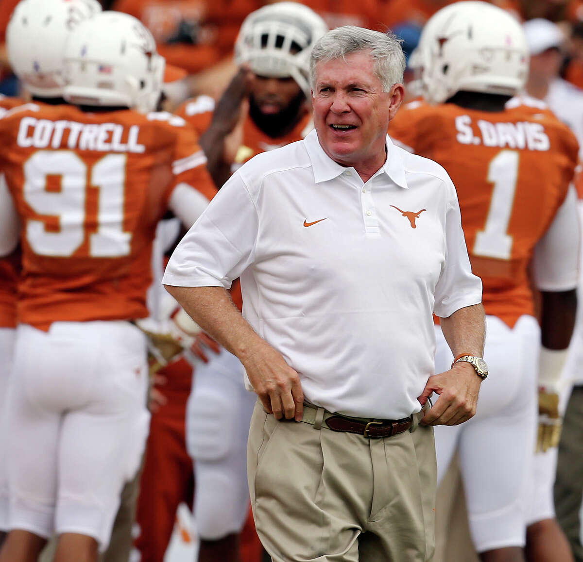 Texas Longhorns head coach Mack Brown watches the team before the Red River Rivalry against the Oklahoma Sooners held Saturday Oct. 12, 2013 at Cotton Bowl Stadium in Dallas, Tx.