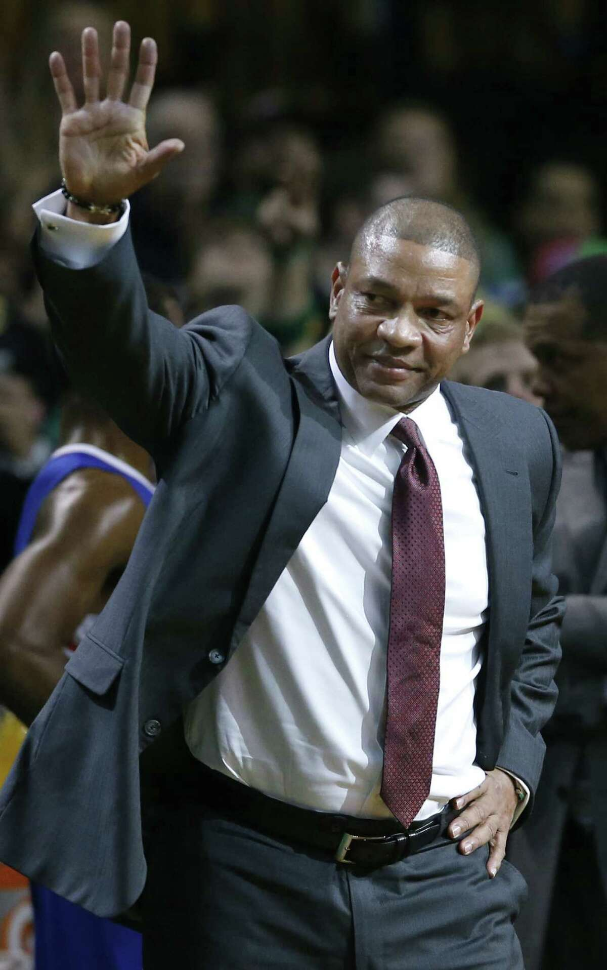 Clippers coach Doc Rivers, formerly of the Celtics, waves during a video tribute in Boston.