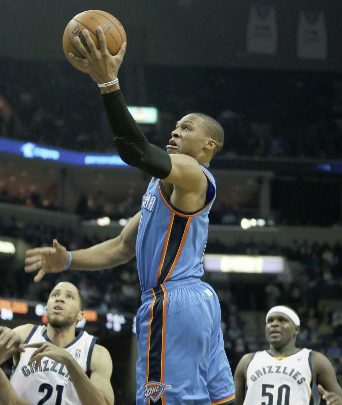 Oklahoma City's Russell Westbrook meets little resistance on his way to the basket as Memphis' Tayshaun Prince (left) and Zach Randolph look on.
