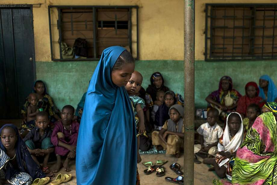 A young woman holds her baby in an elementary school of the muslim district of Bangui on December 11, 2013. France launched Operation Sangaris last week after a day of attacks mainly targeting Muslims left nearly 400 people dead in Bangui, according to the French government. TOPSHOTS/AFP PHOTO / FRED DUFOURFRED DUFOUR/AFP/Getty Images Photo: Fred Dufour, AFP/Getty Images