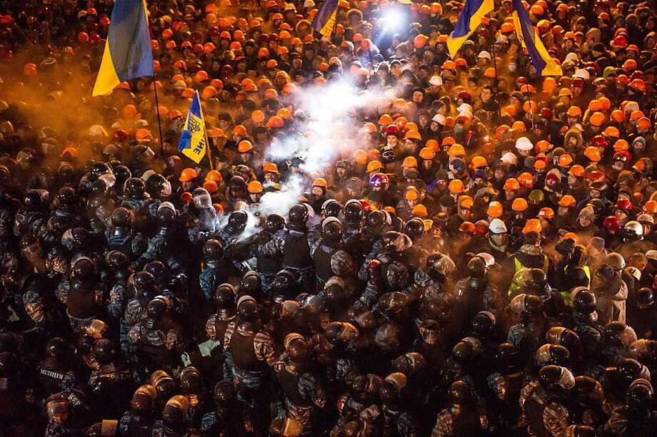 """TOPSHOTS Riot police clash with pro-EU protesors on Independence Square in Kiev early on December 11,2013. Ukrainian security forces  stormed Kiev's Independence Square which protesters have occupied for over a week but the demonstrators defiantly refused to leave and resisted the police in a tense standoff. Eite Berkut anti-riot police and interior ministry special forces moved against the protestors at around 2:00 am (midnight GMT) in a move that prompted US Secretary of State John Kerry to express """"disgust"""" over the crackdown. AFP PHOTO / VOLODYMYR SHUVAYEVVOLODYMYR SHUVAYEV/AFP/Getty Images Photo: Volodymyr Shuvayev, AFP/Getty Images"""