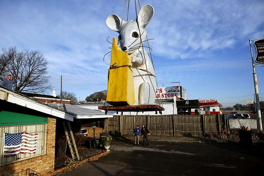 The big cheese of the company:If you have a mouse this large in your house, you'll probably should call the   National Guard instead of Atomic Pest Control, which is moving its rooftop rodent display from Memphis,   Tenn., to new quarters in Ringgold, Ga. Photo: Brad Vest, Associated Press