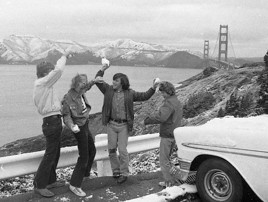 Feb. 5, 1976: The rare San Francisco snow day. I'm thinking how much fun it must have been to be these kids -- sliding through the snow-dusted city, 8-track blaring, finally parking at Lands End to get the greatest view in snowball fight history. Photo: Clem Albers, The Chronicle / ONLINE_YES