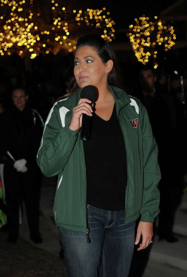 The Woodlands High School Head Band director Joni Perez talks about her band's 2013 Grand National Championship at a parade and celebration in Market Street in The Woodlands on Wednesday. Photo: Jerry Baker, For The Chronicle