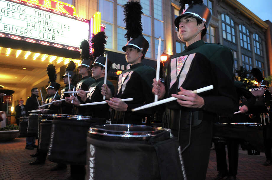 The Woodlands High School Marching Band performs during a parade in Market Street in The Woodlands on Wednesday celebrating their 2013 Grand National Championship. Photo: Jerry Baker, For The Chronicle
