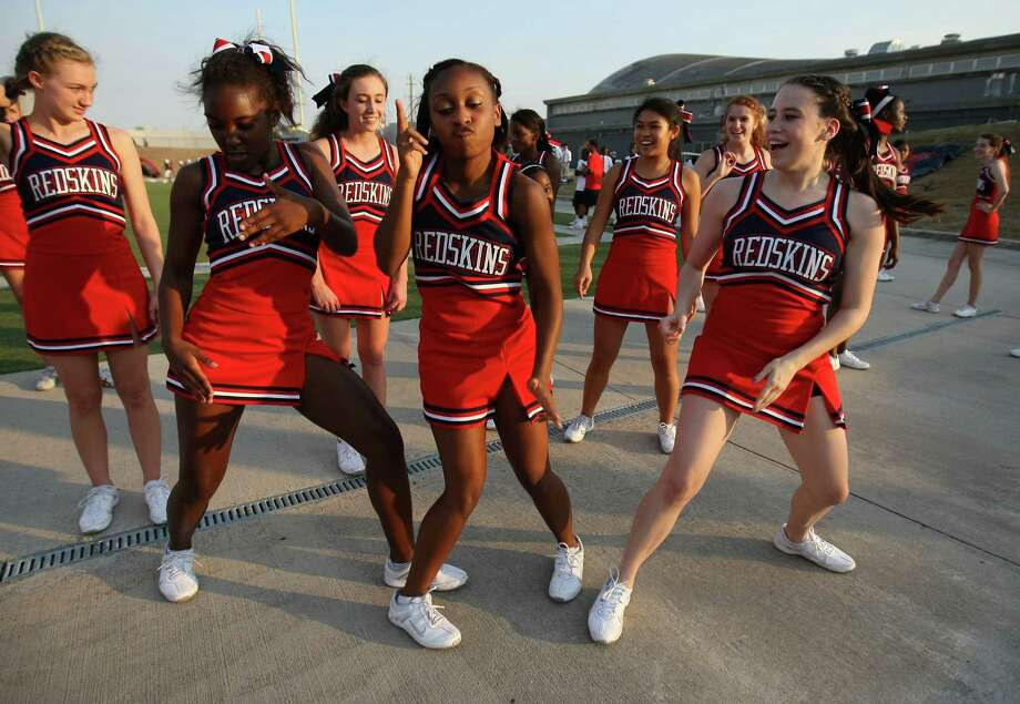 Lamar cheerleaders (left to right) Moriah Sells, Lauren Morgan and Payton Hernandez dance before the Redskins' game against the Brenham Cubs, Friday at Delmar Stadium. Photo: Eric Christian Smith, Freelance