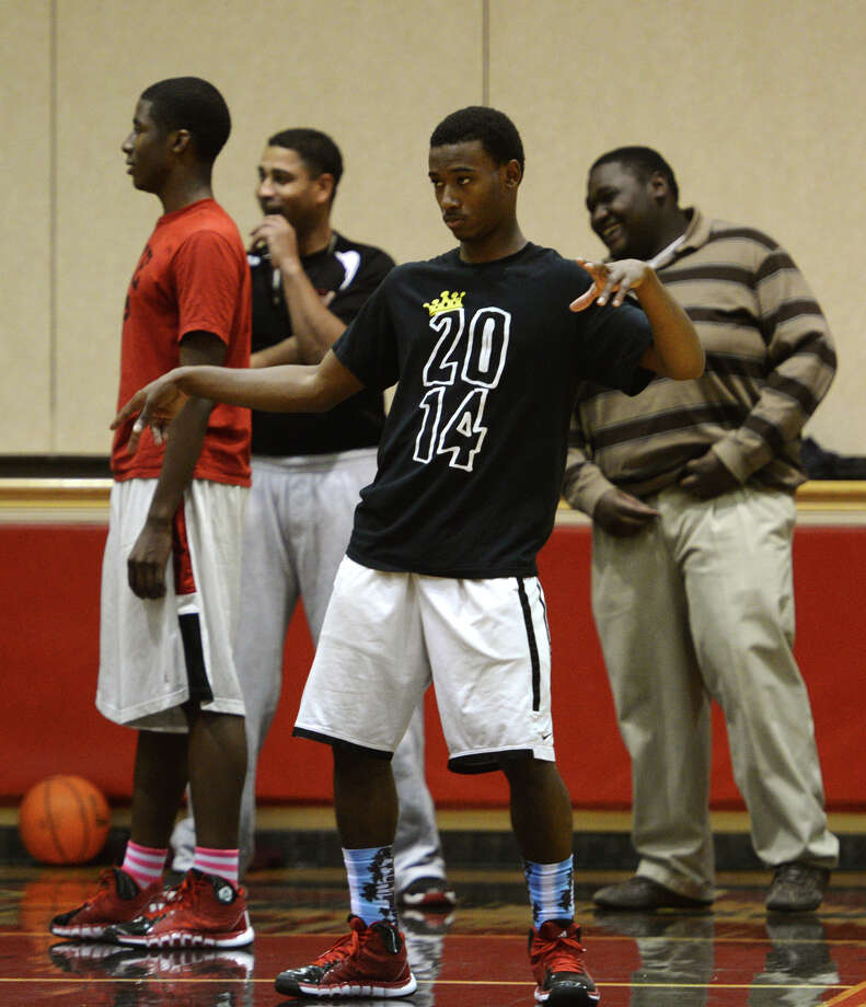 Brandon Hooper stays loose during practice Monday at Kountze High School. The highly ranked Kountze High School basketball team practiced at the school gym Monday afternoon. Photo taken Jake Daniels/@JakeD_in_SETX Photo: Jake Daniels / ©2013 The Beaumont Enterprise/Jake Daniels