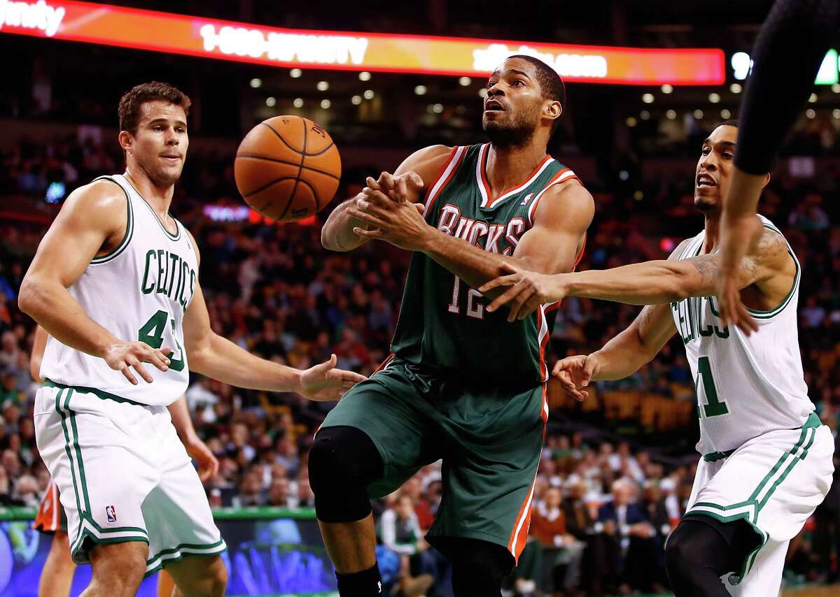 BOSTON, MA - DECEMBER 03: Gary Neal #12 of the Milwaukee Bucks has the ball stripped from him by Courtney Lee #11 of the Boston Celtics in the second half during the game at TD Garden on December 3, 2013 in Boston, Massachusetts. NOTE TO USER: User expressly acknowledges and agrees that, by downloading and or using this photograph, User is consenting to the terms and conditions of the Getty Images License Agreement.