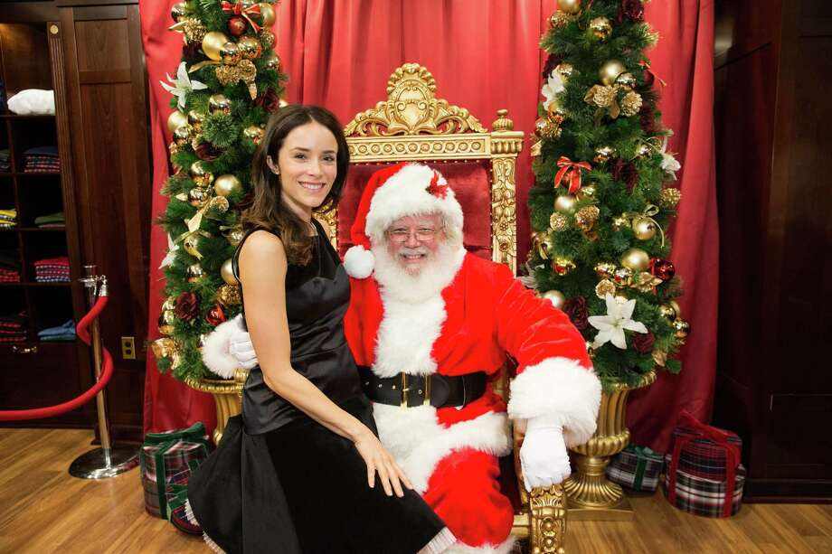 Abigail Spencer poses on Santa's lap during Brooks Brothers' Holiday Celebration on December 10, 2013. Photo: Drew Altizer Photography/SFWIRE, Drew Altizer Photography / ©2013 by Drew Altizer, all rights reserved