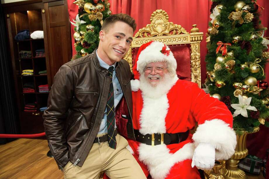 Colton Haynes shares a seat with Santa during Brooks Brothers' Holiday Celebration on December 10, 2013. Photo: Drew Altizer Photography/SFWIRE, Drew Altizer Photography / ©2013 by Drew Altizer, all rights reserved