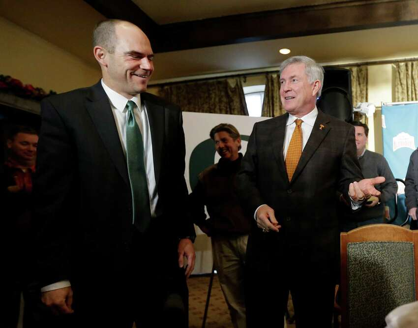Oregon coach Mark Helfrich, left, and Texas coach Mack Brown, right, visit following a Valero Alamo Bowl news conference, Thursday, Dec. 12, 2013, in San Antonio. Texas and Oregon will play in the NCAA college football game Dec. 30. (AP Photo/Eric Gay)