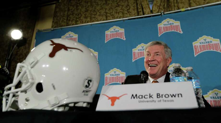 Texas coach Mack Brown responds to a question during a Valero Alamo Bowl NCAA college football news conference, Thursday,  Dec. 12, 2013, in San Antonio. Texas and Oregon will play Dec. 30. (AP Photo/Eric Gay) Photo: Eric Gay, Associated Press / AP