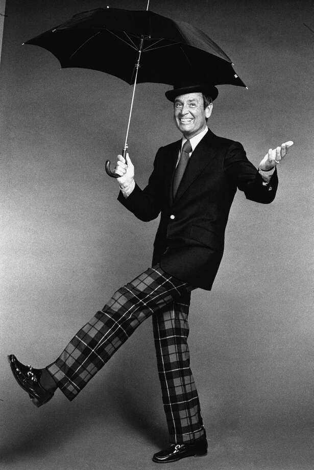 1973: Bob Barker wears a bowler hat and plaid pants as he cavorts with an umbrella. Photo: CBS Photo Archive, Getty Images / 2006 CBS WORLDWIDE INC.
