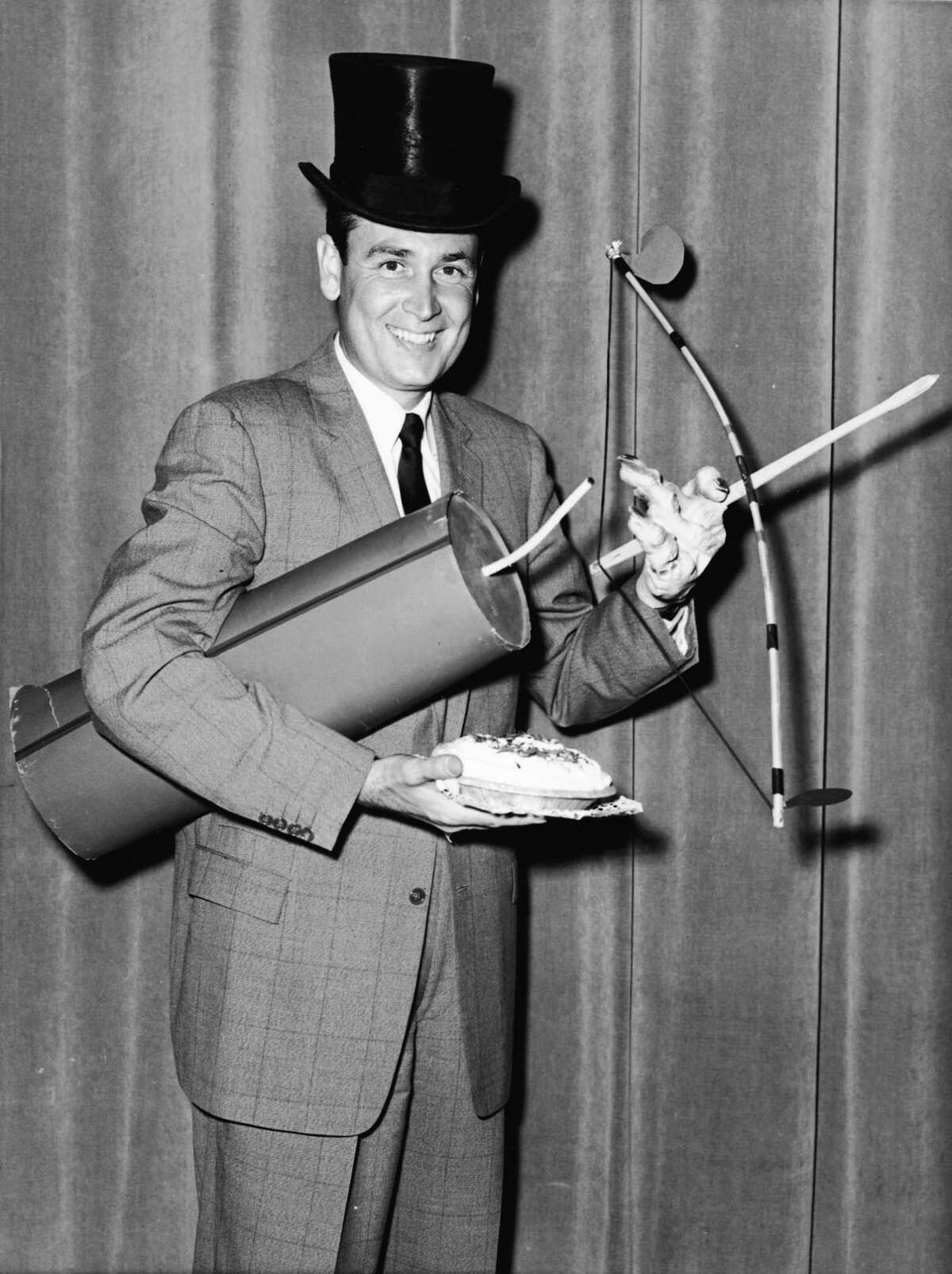 1957: Bob Barker poses with a number of props in preparation for hosting the television show