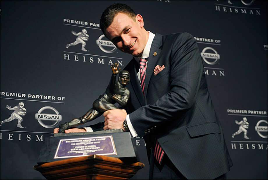 Johnny Manziel now returns to the scene of his groundbreaking Heisman win in 2012. Photo: Henny Ray Abrams, AP2012 / AP2012
