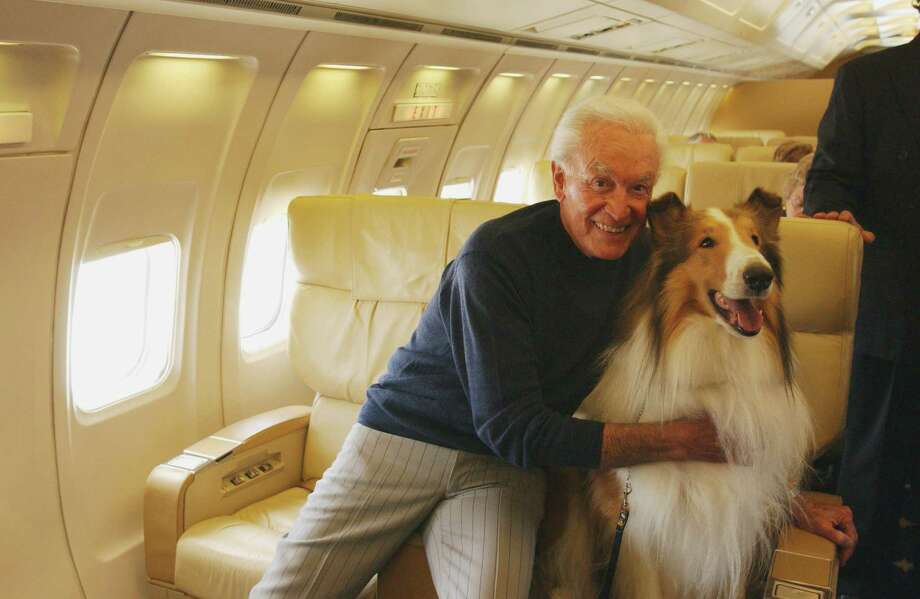 2003: Howard, best known as Lassie, poses with Bob Barker on a chartered plane. Photo: CLIFF LIPSON, Getty Images / ©2003 CBS WORLDWIDE INC. ALL RIGHTS RESERVED.