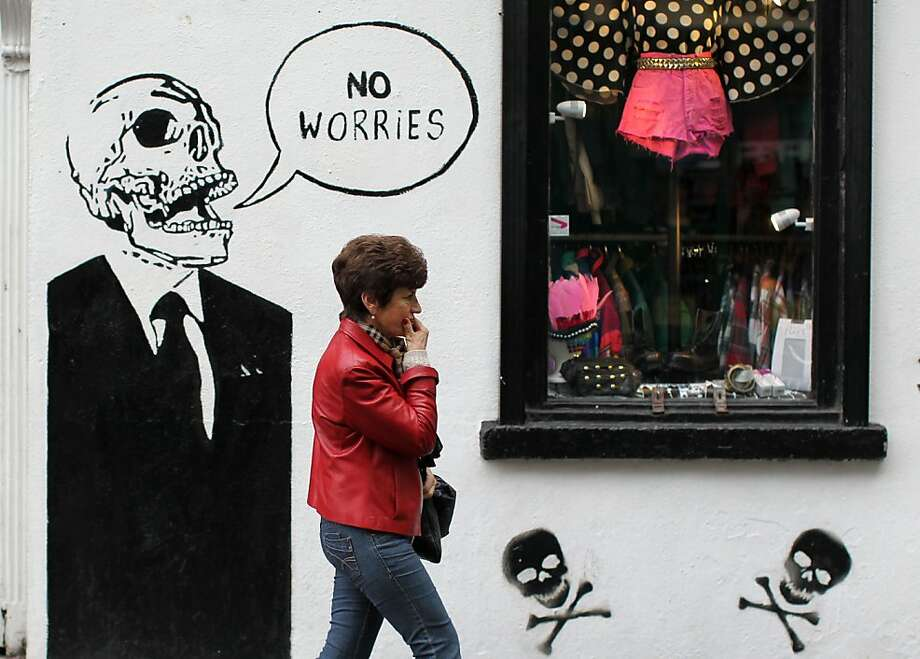 Don't worry, be happy:Graffiti reminiscent of Banksy's work decorates a clothing store in Dublin, Ireland. Photo: Peter Muhly, AFP/Getty Images