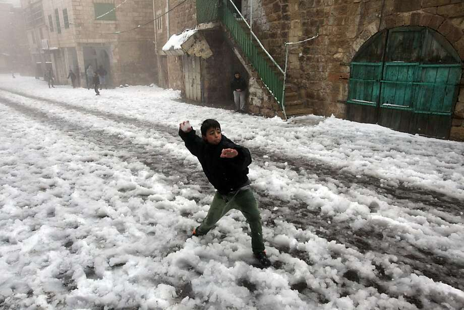 A rare snowball fightbreaks out near the Ibrahimi Mosque, or Tomb of the Patriarch, a religious site sacred to   both Muslims and Jews in the West Bank town of Hebron. Photo: Hazem Bader, AFP/Getty Images