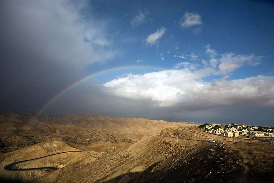 Rain in the desert: A rainbow arcs over the Judean desert following heavy rains near Jerusalem. Photo: Menahem Kahana, AFP/Getty Images