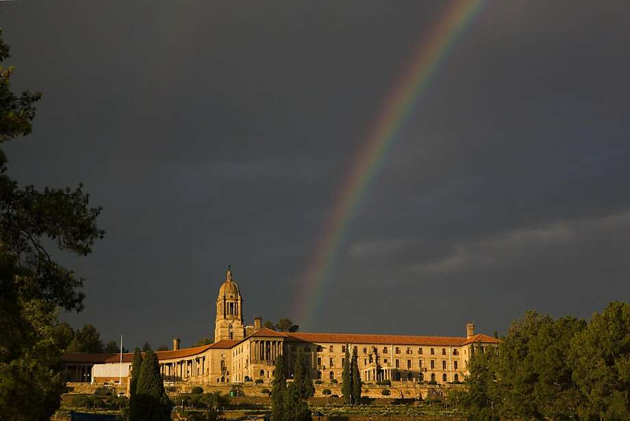 Mandela's rainbow: A rainbow forms over the Union Buildings in Pretoria, South Africa, after the public viewing of Nelson Mandela's casket lying in state finished for the day. Photo: Matt Dunham, Associated Press