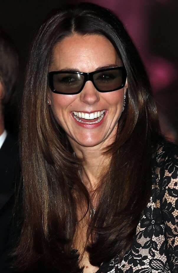 """Duchess in 3-D:Kate wears 3-D glasses before a screening of David Attenborough's """"Natural History Museum Alive 3D"""" at the Natural History Museum in London. The Duchess of Cambridge is a patron of the museum. Photo: Suzanne Plunkett, Associated Press"""
