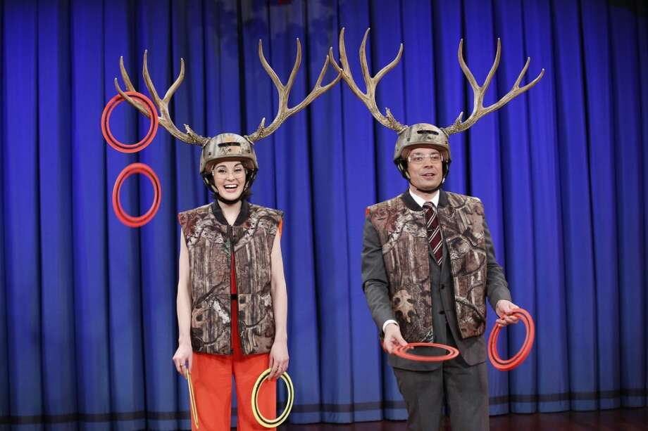 "Jimmy Fallon plays antler ring toss with ""Downton Abbey""'s Michele Dockery on Tuesday, December 10, 2013 on Fallon's talk show. Photo: NBC, NBCU Photo Bank Via Getty Images"