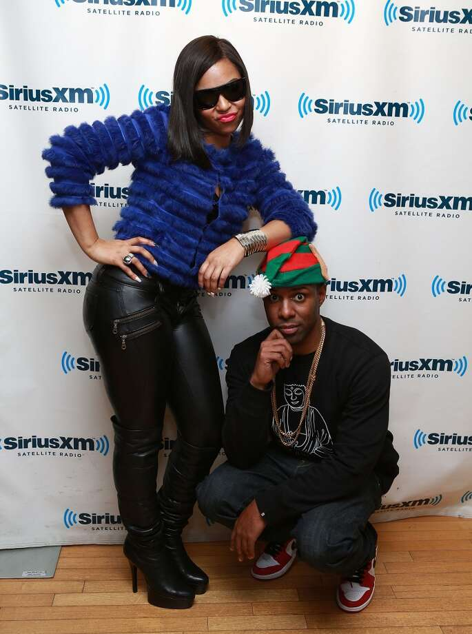 Ashanti (L) and DJ Whoo Kid visit at SiriusXM Studios on December 10, 2013 in New York City. Photo: Robin Marchant, Getty Images