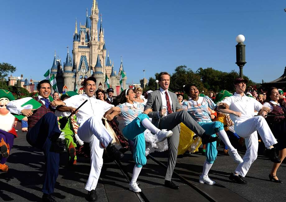 Actor Neil Patrick Harris hosts and performs in the Disney Parks Christmas Day Parade television special at Magic Kingdom Park at the Walt Disney World Resort on December 07, 2013 in Lake Buena Vista, Florida. The parade will air on December 25. Photo: Handout, Getty Images
