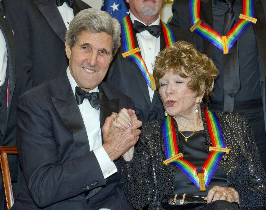 United States Secretary of State John F. Kerry and Shirley MacLaine attend the formal Artist's Dinner honoring the recipients of the 2013 Kennedy Center Honors hosted by United States Secretary of State John F. Kerry at the U.S. Department of State on December 7, 2013 in Washington, D.C. The 2013 honorees are: opera singer Martina Arroyo, musician/composer Herbie Hancock, singer/songwriter Billy Joel, actress Shirley MacLaine, and musician/songwriter Carlos Santana. Photo: Pool, Getty Images