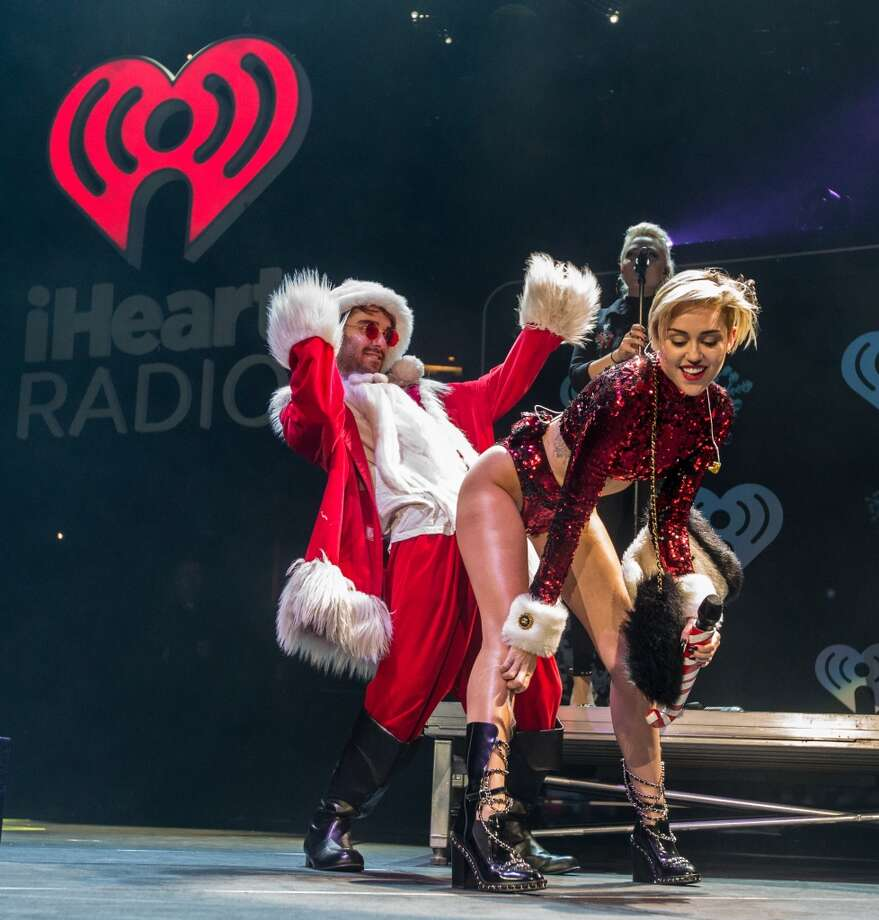 Miley Cyrus twerks with Santa during KIIS FM's Jingle Ball 2013 at Staples Center on December 6, 2013 in Los Angeles, CA.  (Photo by Christopher Polk/Getty Images for Clear Channel) Photo: Christopher Polk, Getty Images For Clear Channel
