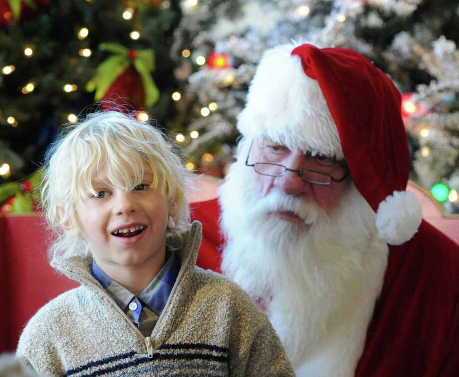 Bonham O'Marra, 5, of Bethel, Conn., meets with Santa during a visit to Santa's Workshop at McArdle's Florist & Garden Center in Central Greenwich, Thursday, Dec. 12, 2013. Photo: Bob Luckey / Greenwich Time