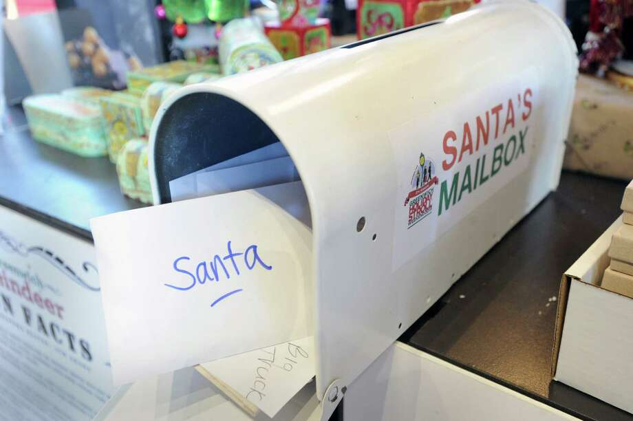 Letters to Santa stick out of a mailbox in Santa's Workshop at McArdle's Florist & Garden Center in Central Greenwich, Thursday, Dec. 12, 2013. Photo: Bob Luckey / Greenwich Time