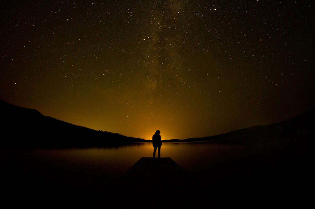 Stargazing at the Half Moon Lake (Pinedale, Wyo.) It was our final night of fun after three days of interacting with the locals of Pinedale, WY. The stars were amazing so we decided to check them out at a lake we had yet to see. A glow from the small town crept over the distant horizon and faded into the star-filled sky. Just as we were leaving I noticed Danielle standing at the end of the dock and told her to freeze. I thought it was beautiful how Danielle and the dock happened to line up with the milky way.