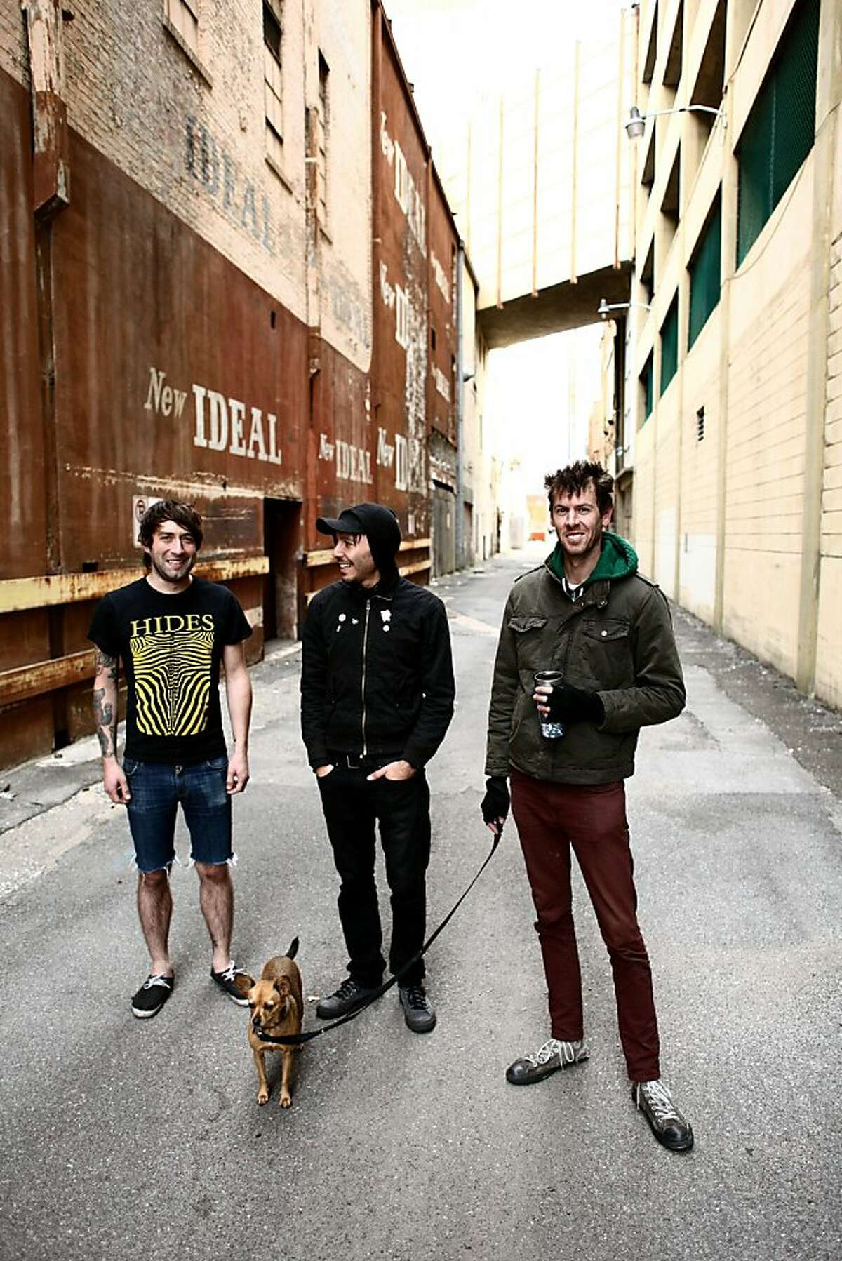 Catch em while you can: Cobra Skulls (left to right: guitarist Tony Teixeira, drummer Luke Ray, vocalist-bassist Devin Peralta) with dog Bella, who tours with them, are calling it quits.