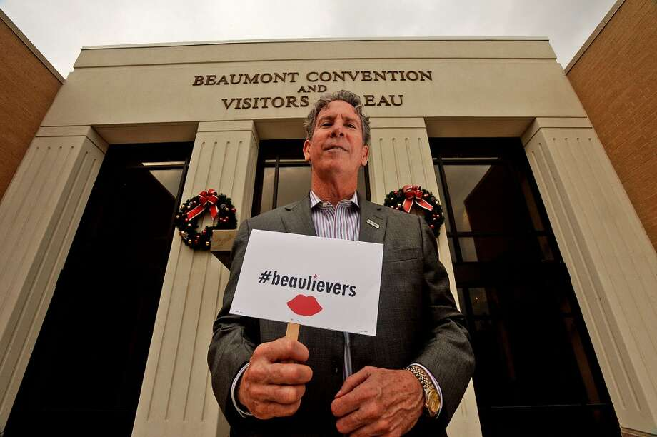 Executive director of the Beaumont Convention & Visitors Bureau Dean E. Conwell holds a sign that reads #Beaulievers outside of the Beaumont Convention and Visitors Bureau on Wednesday. Michael Rivera/@michaelrivera88