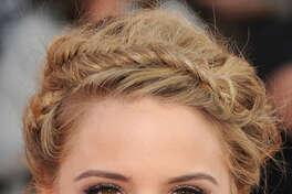 Braided Beauty: Tame face-framing frizz by trying out head-hugging fishtail plaits, like Dianna Agron.